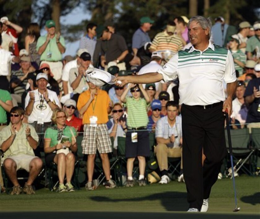 Fred Couples tips his cap after putting out on the 18th green during the third round of the Masters golf tournament Saturday, April 7, 2012, in Augusta, Ga. (AP Photo/Matt Slocum)