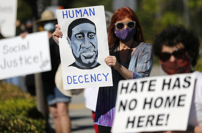 Cyndee Whitney, 73, joins a protest in support of Black Lives Matter along El Toro Road in Laguna Woods.