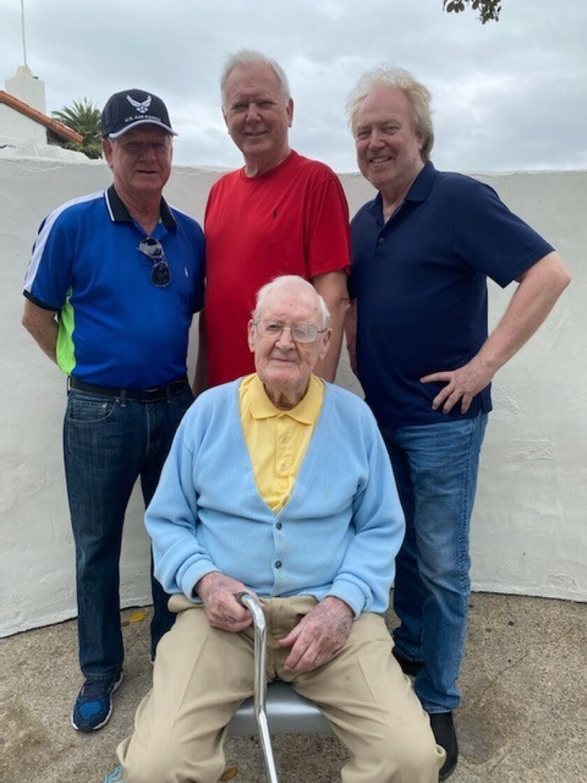 Looking forward to a 100th birthday with family, Don Sweet, front, with his sons, from left, Mike, Don Jr., and Terry Sweet.
