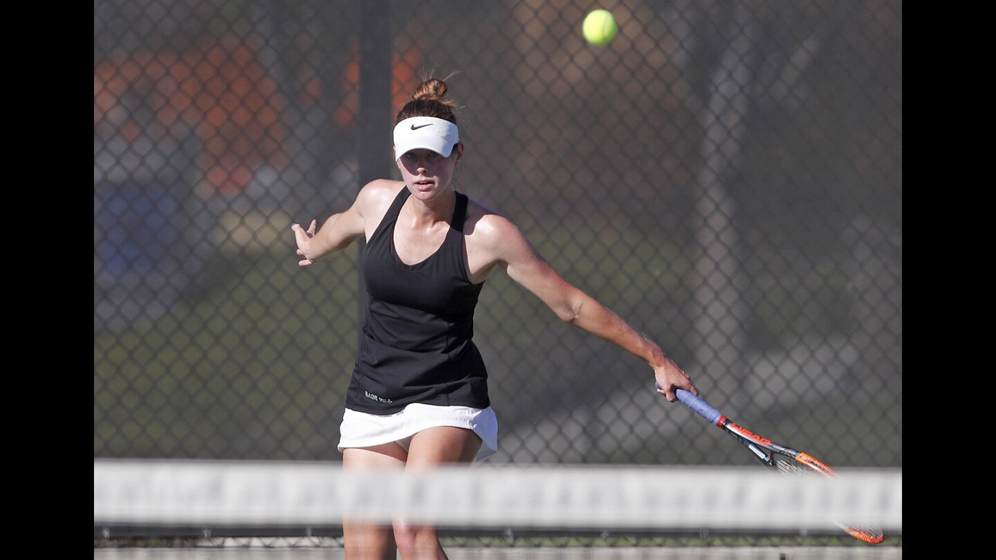 Sage Hill School's Morgan Mann follows through with a backhand in a No. 1 singles set against St. Margaret's during a San Joaquin League match in Newport Beach on Tuesday, Oct. 16.