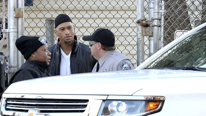 Former Carolina Panthers NFL football player Rae Carruth, center, exits the Sampson Correctional Ins