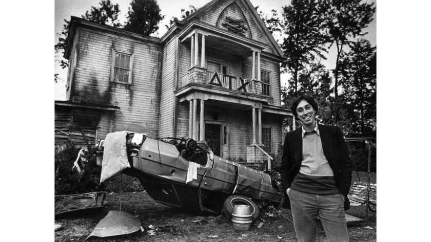 """Jan. 23, 1979: Ivan Reitman, co-producer of """"Animal House,"""" poses before the fraternity house edifice constructed at Universal Studios for the spinoff television show """"Delta House."""""""