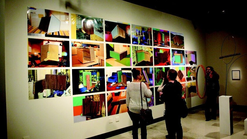 A wall of digital prints in the Calit2 Gallery.