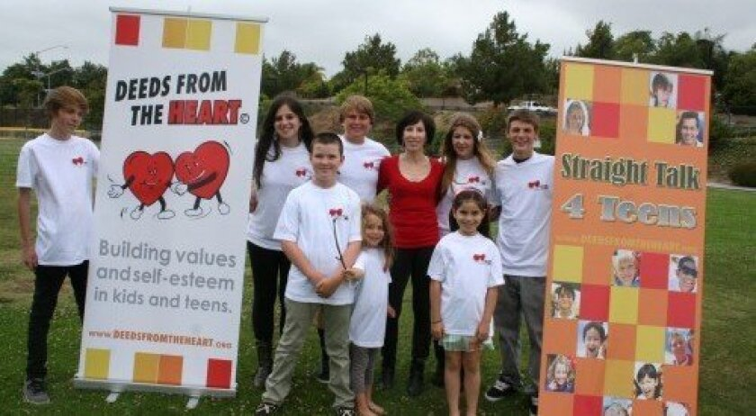 Nancie Hochberg, center, is the founder of Deeds From the Heart and Straight Talk 4 Teens. Photo: Karen Billing