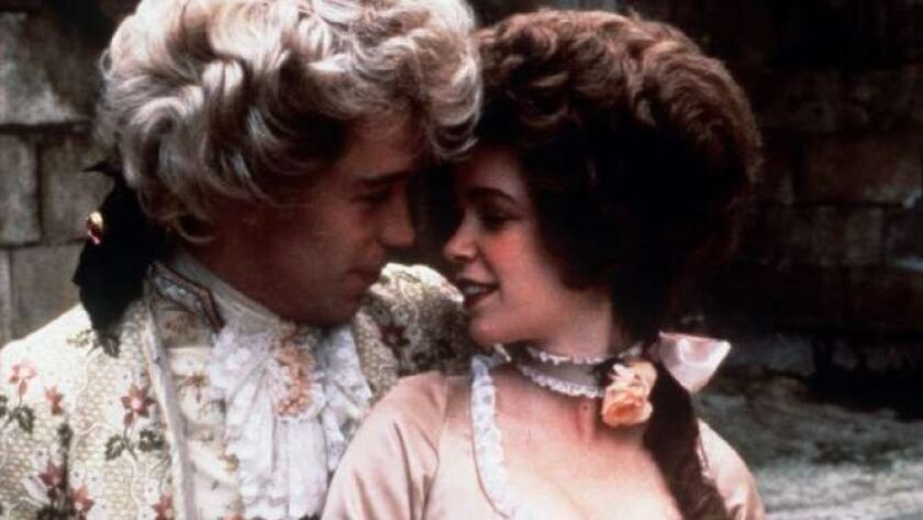 "Tom Hulce as Wolfgang Amadeus Mozart and Elizabeth Berridge as Constance Mozart in ""Amadeus."""