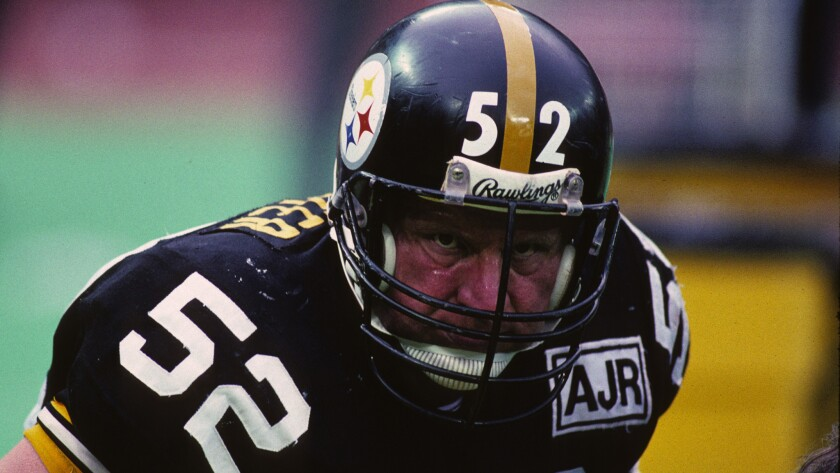 Pittsburgh Steelers center Mike Webster looks on from the sideline during a game in December 1988. Webster, who died from a heart attack in 2002 at age 50, suffered from a neurodegenerative disease.
