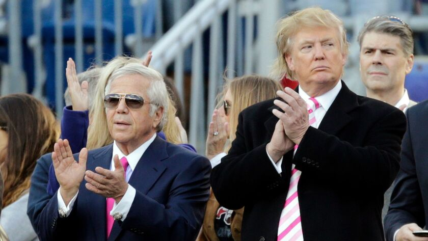 New England Patriots owner Robert Kraft, left, and businessman Donald Trump, right, applaud on the field before an NFL football game between the Patriots and the New York Jets in Foxborough, Mass in 2012.