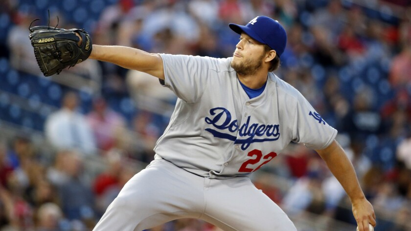 Dodgers starter Clayton Kershaw delivers a pitch during the team's 8-3 win over the Washington Nationals on Tuesday. It was Kershaw's first game since pitching in the Dodgers' season opener in Australia.
