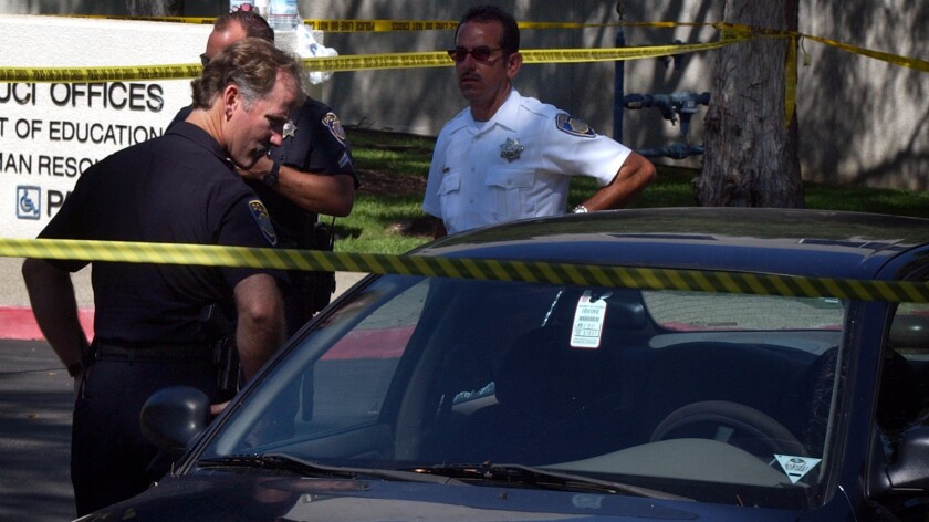 Irvine police investigate the death of an infant found in a car seat inside a parked vehicle at UC Irvine in August 2003.