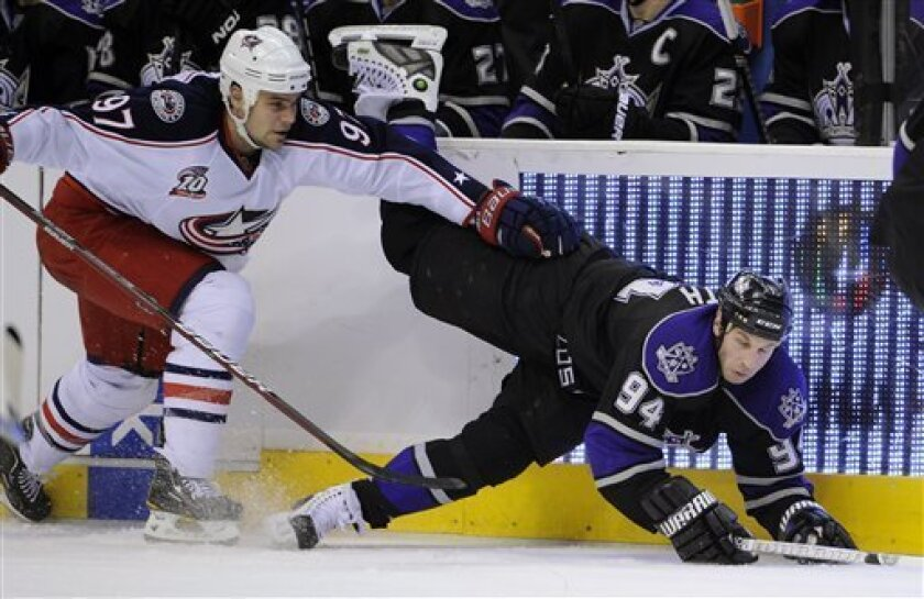Los Angeles Kings left wing Ryan Smyth, right, falls as he goes after the puck along with Columbus Blue Jackets defenseman Rostislav Klesla of the Czech Republic during the second period of their NHL hockey game, Saturday, Jan. 8, 2011, in Los Angeles. (AP Photo/Mark J. Terrill)