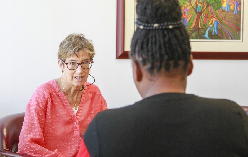 Aliyah (right), who is from Cameroon and did not want to be fully identified, talks to her attorney Nancy Aeling at the Casa Cornelia law offices in Bankers Hill on October 11, 2019 in San Diego, California. Aliyah recently won her asylum case.