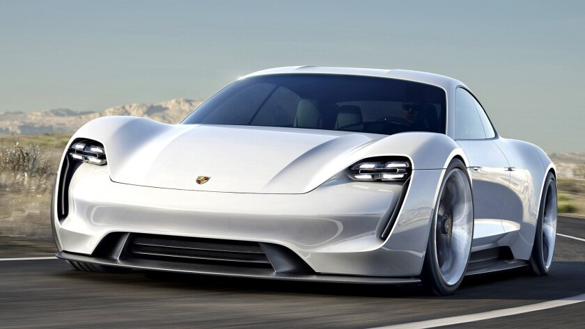 Porsche has unveiled an all-electric sports car concept. The vehicle will boast 600 horsepower, a range of over 300 miles, and a charge time of 15 minutes, the company said.