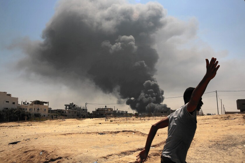 Smoke rises from a power plant in the Gaza Strip after a night of Israeli bombing in July.