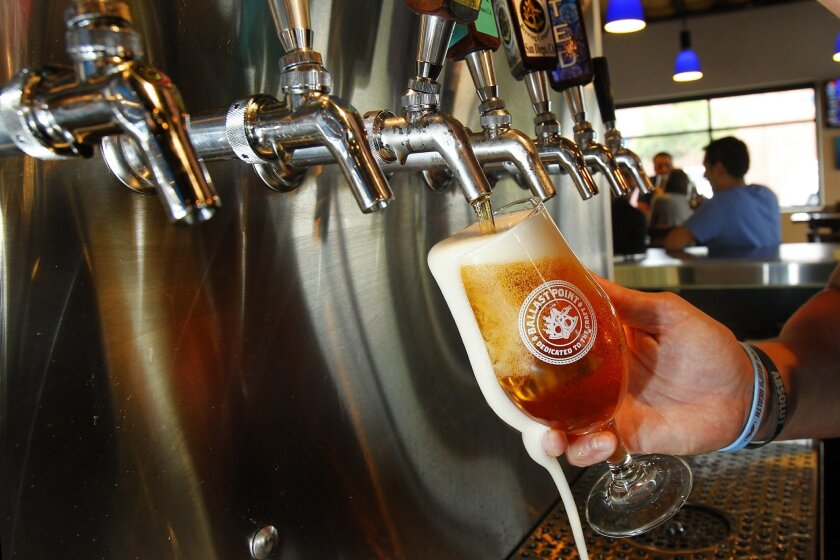 Ballast Point pale ale is poured at the Ballast Point Tasting Room & Kitchen in Little Italy.
