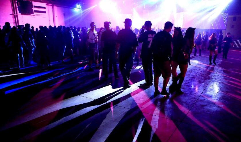 Electronic music fans dance during the first evening of the Hard Day of the Dead rave at Fairplex on Nov. 1, 2014 in Pomona. (Brian van der Brug / Los Angeles Times)