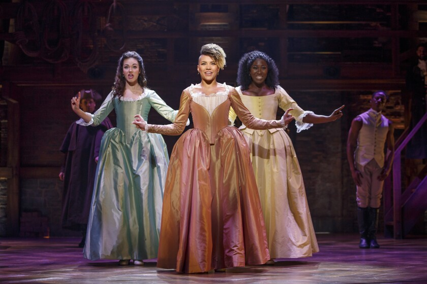 Emmy Raver-Lampman as Angelica, flanked by Solea Pfeiffer as Eliza, left, and Amber Iman as Peggy in