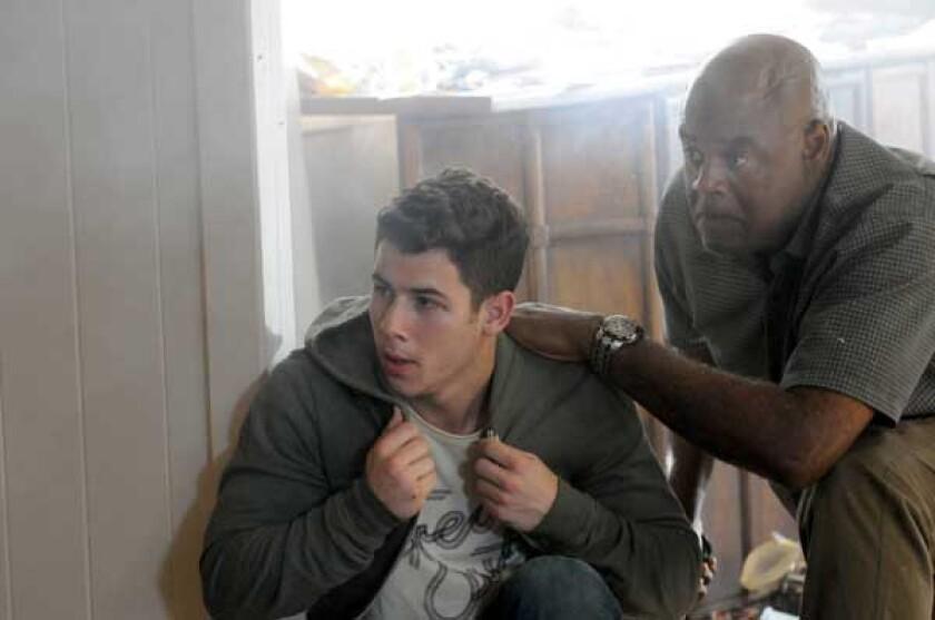 "Nick Jonas, left, and Chi McBride in ""Hawaii Five-0"" on CBS."