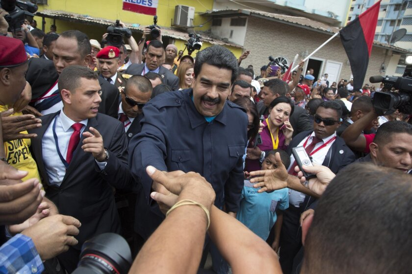 Venezuelan President Nicolas Maduro greets supporters before a ceremony at a monument for those who died during the 1989 U.S. invasion of Panama in the Chorrillo neighborhood in Panama City on April 10.
