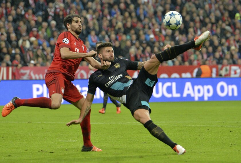 Arsenal's Olivier Giroud scores during the Champions League Group F soccer match between Bayern Munich and Arsenal FC in Munich, southern Germany, Wednesday, Nov. 4, 2015. (AP Photo/Kerstin Joensson)