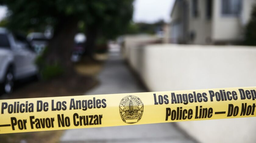 PACOIMA, CALIF. - MAY 30: Police Officers at the scene of an officer involved shooting near the 1090