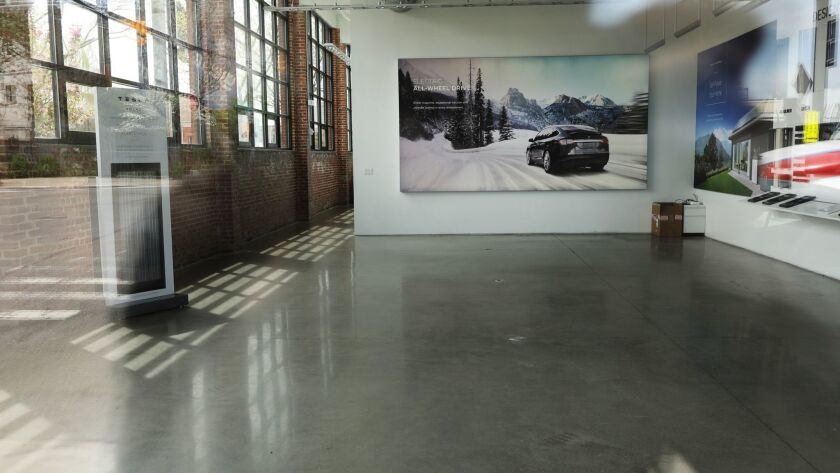An empty Tesla retail store in Brooklyn, N.Y. Chief Executive Elon Musk is closing stores in favor of online sales, one way to preserve precious cash.