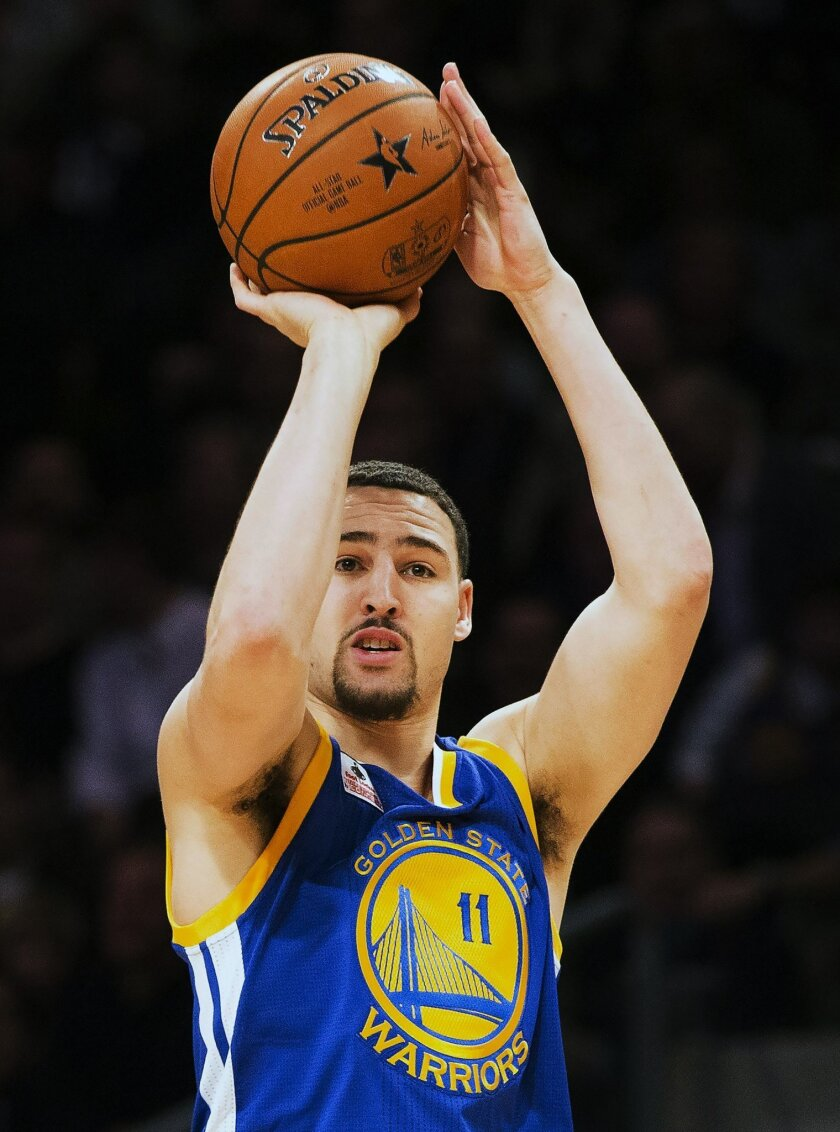 Golden State Warriors guard Klay Thompson (11) wins the three point competition during the NBA all-star skills competition in Toronto on Saturday, Feb. 13, 2016. (Mark Blinch/The Canadian Press via AP) MANDATORY CREDIT