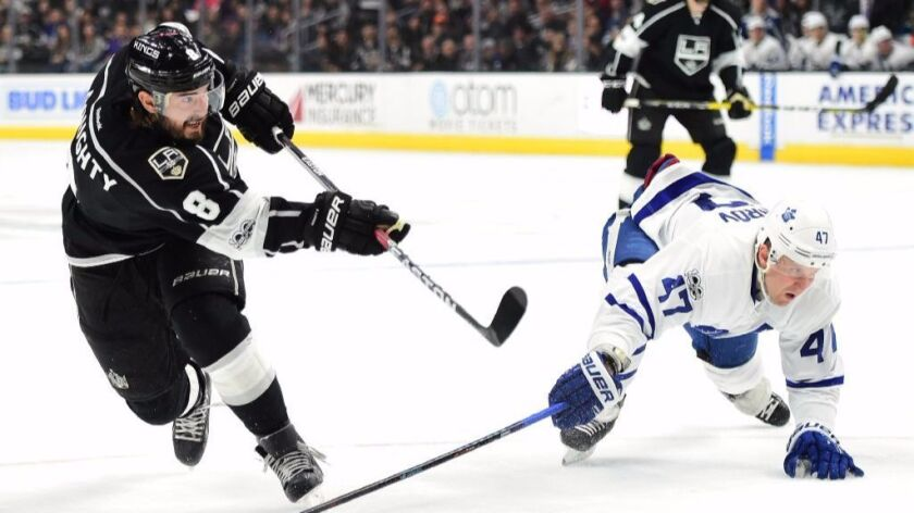 Kings defenseman Drew Doughty (8) takes a slap shot as Maple Leafs' Leo Komarov (47) attempts to block during the second period on Mar. 2.