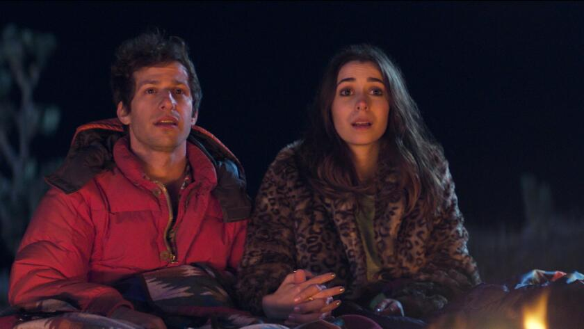 "Andy Samberg and Cristin Milioti in the movie ""Palm Springs."""
