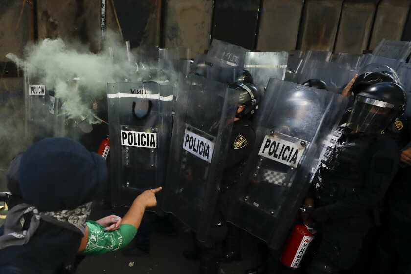 Anarchist protesters face off against police in the Polanco neighborhood of Mexico City