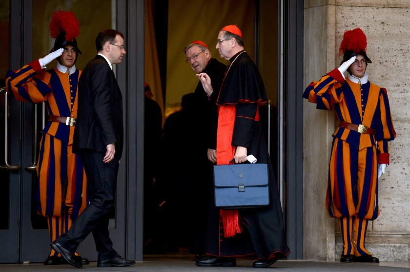 Cardinals Raymond Burke, center left, and Roger M. Mahony, with briefcase, at the Vatican in March 2013, during the selection process for a new pope.