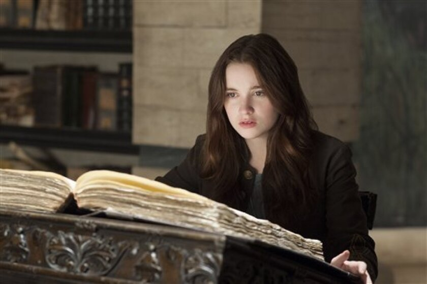 """This film image released by Warner Bros. Pictures shows Alice Englert in a scene from """"Beautiful Creatures."""" (AP Photo/Warner Bros. Pictures, John Bramley)"""