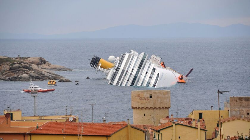 This file photo taken on Jan. 16, 2012, shows the wrecked cruise liner Costa Concordia in the harbor