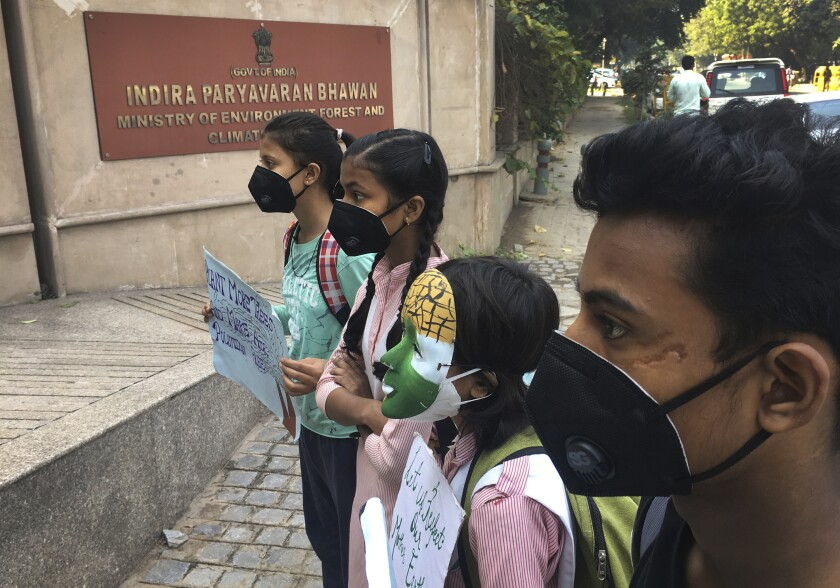 Schoolchildren protest outside the Indian Environment Ministry against alarming levels of pollution in the city, in New Delhi, India, Tuesday, Nov. 5, 2019. Air pollution in New Delhi and northern Indian states peaks in the winter as farmers in neighboring agricultural regions set fire to clear land after the harvest and prepare for the next crop season. The pollution in the Indian capital also peaks after Diwali celebrations, the Hindu festival of light, when people set off fireworks. (AP Photo/Shonal Ganguly)