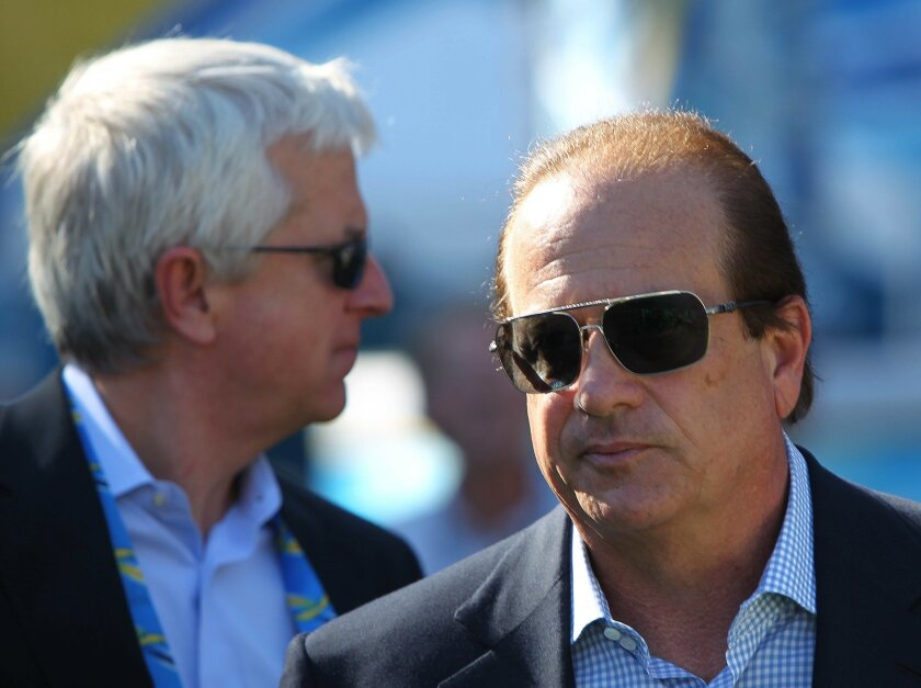 Chargers president Dean Spanos (right) and his special counsel, Mark Fabiani, have wanted a new stadium since 2002.