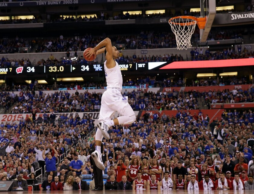 Kentucky's Trey Lyles (41) dunks the ball ahead of Wisconsin's Zak Showalter during the first half of the NCAA Final Four tournament college basketball semifinal game Saturday, April 4, 2015, in Indianapolis. (AP Photo/Michael Conroy)