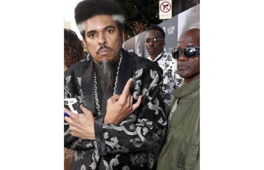 """Shock G, left, poses at the """"All Eyez On Me"""" film premiere in Los Angeles on June 14, 2017.  (Nzazi Malonga via AP)"""