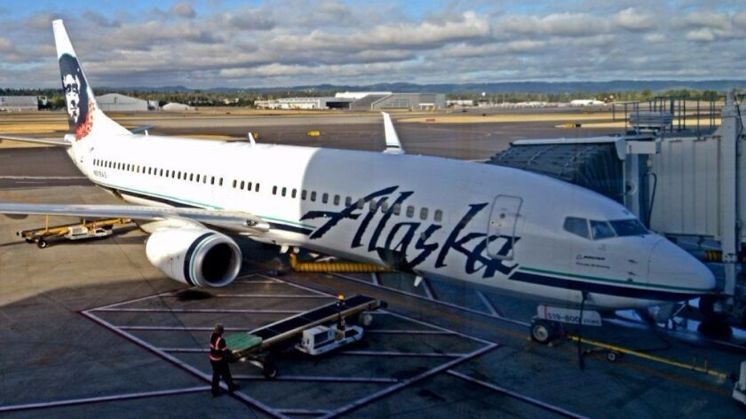 An Alaska Airlines jet prepares to take off from Portland International Airport in Oregon. The Seattle-based airline plans to upgrade to satellite-based Wi-Fi, starting next year.