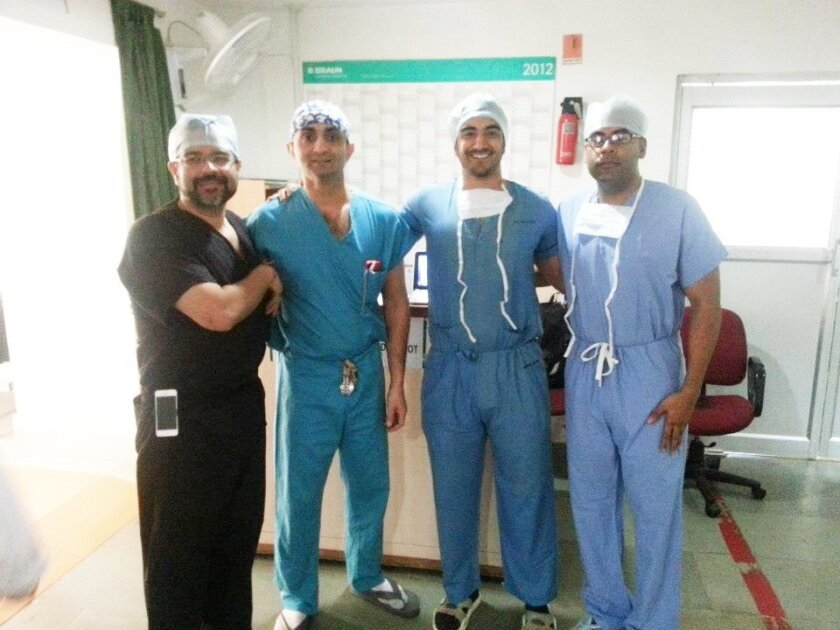 Dr. Munish Batra of Rancho Santa Fe at left in black, with other doctors on a previous mission. Courtesy photos