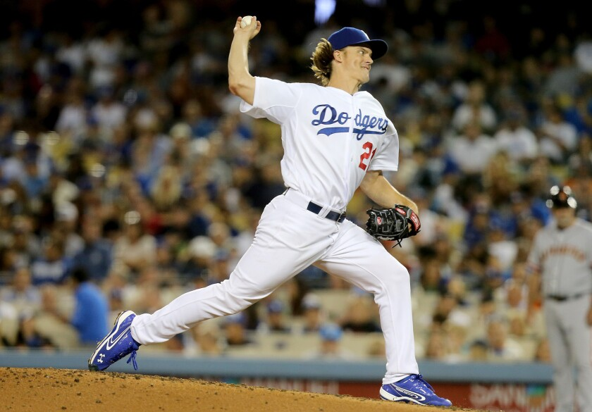 Dodgers starting pitcher Zack Greinke delivers a pitch during the second inning of a game against the Giants on Sept. 1.