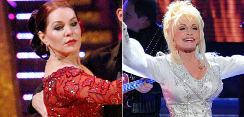 WHAT'S GOING ON? Priscilla Presley, left, and Dolly Parton don't seem quite themselves.