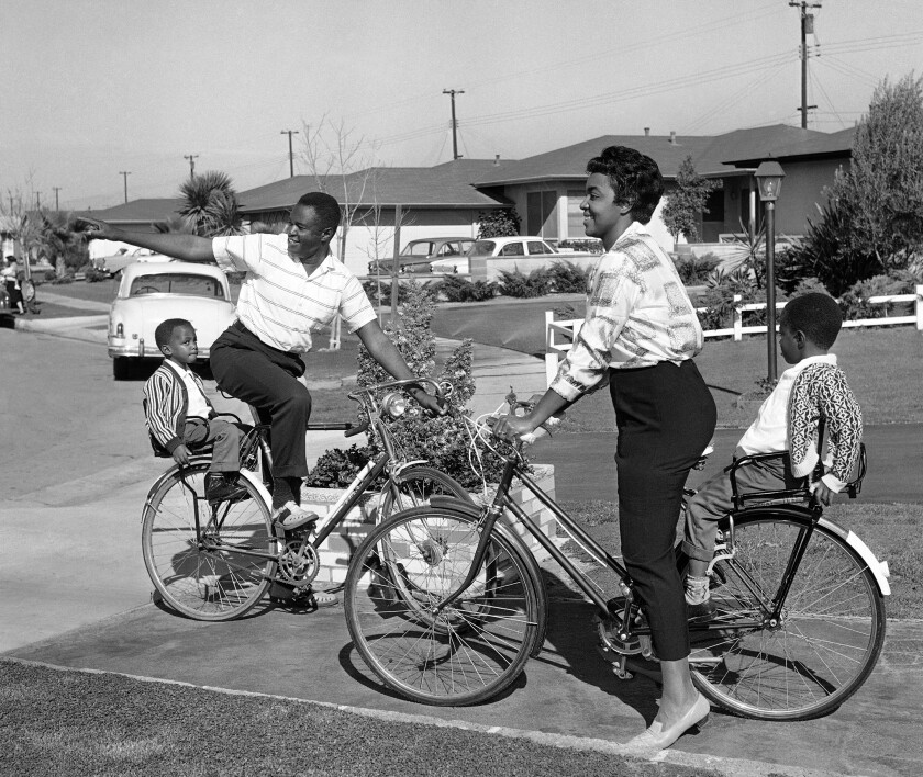A family of four on bicycles in Gardena in 1962.