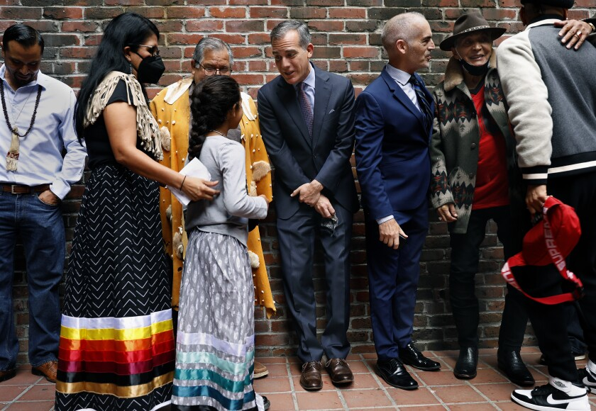 Mayor Eric Garcetti talks with members of the Gabrieleno/Tongva tribe, left, including 9-year-old Ellie Morales Recalde.