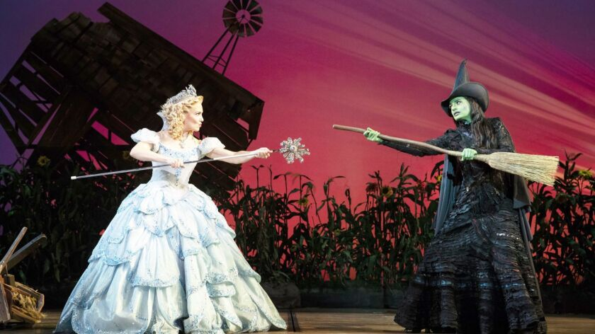 """Kara Lindsay as Glinda and Jackie Burns as Elphaba reprise their Broadway roles in the national tour of """"Wicked,"""" playing at the San Diego Civic Theatre through Nov. 25."""