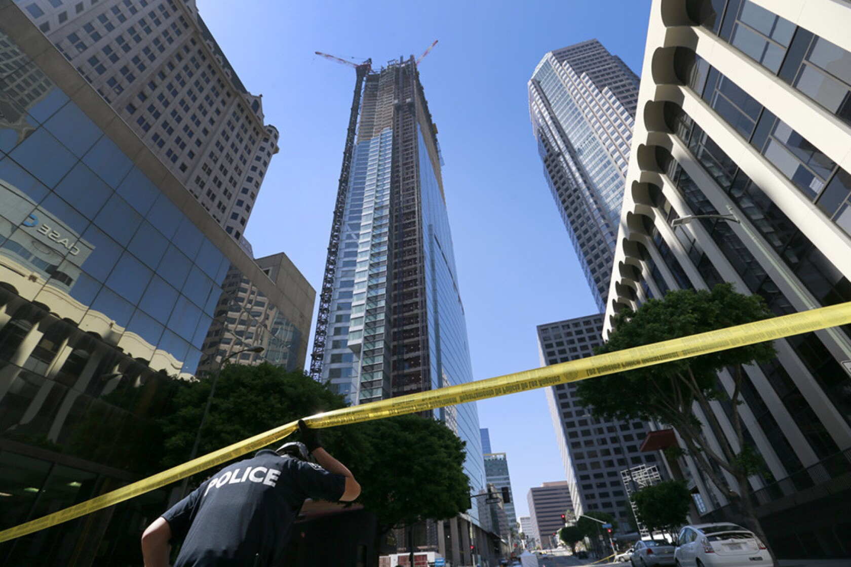 Construction worker falls from L A  high-rise, hits cars and