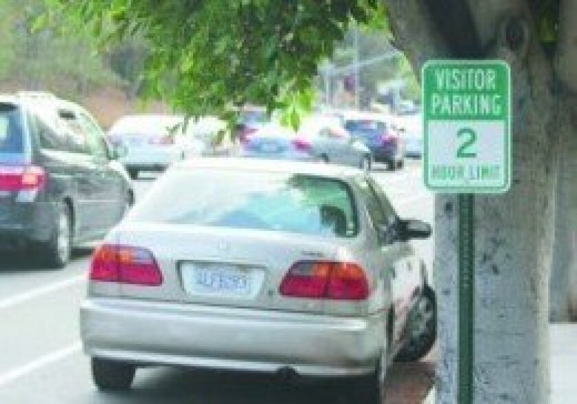 City officials say signs like this one in front of the La Jolla Nursing and Rehabilitation Center at 2552 Torrey Pines Rd. were not installed by the city and will be removed. The city is investigating who painted the curb in front of the facility green.
