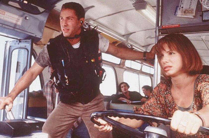 "Keanu Reeves and Sandra Bullock in the movie ""Speed."""