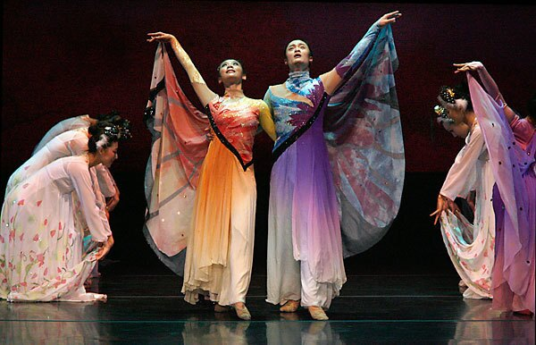 """Shao Junting, center left, and Wang Zihan play the central characters in Beijing Dance Academy's new version of """"The Butterfly Lovers"""" at the Ahmanson Theatre in downtown Los Angeles. A marketing gimmick refers to the story as """"China's Romeo and Juliet."""""""