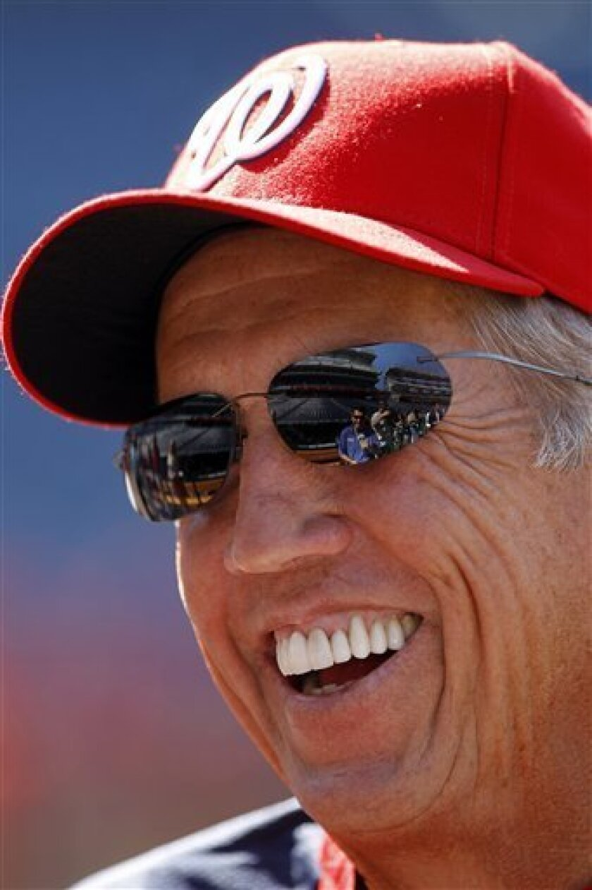 Washington Nationals manager Davey Johnson laughs during an interview before a baseball game against the Pittsburgh Pirates in Washington, Friday, July 1, 2011. (AP Photo/Ann Heisenfelt)