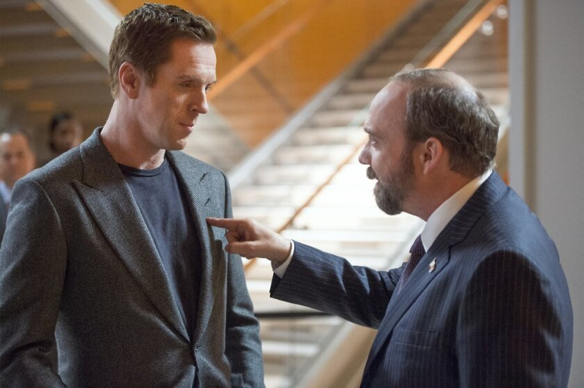 "Damian Lewis, left, portrays Bobby ""Axe"" Axelrod and Paul Giamatti is Chuck Rhoades in Season 1 of ""Billions."""