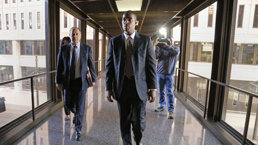 Former Minneapolis FBI agent Terry Albury, front, followed by his attorney Joshua Dratel walk out of